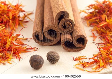 Condiments And Spices On Yellow Wooden Tray