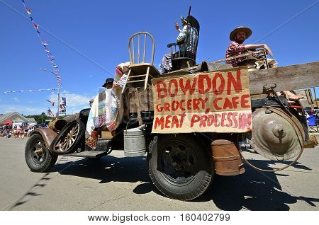 MANDAN, NORTH DAKOTA, July 3, 2016: The 4th of July Rodeo Days  3 day celebration includes the rodeo, Art in the Park, and downtown 4th parade where the Bowden Grocery Store advertises in a jalopy of the Depression ERA