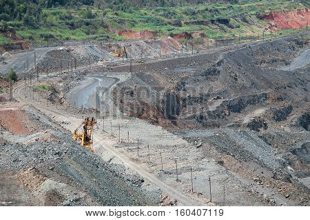 Iron ore opencast mining quarry with excavators at work