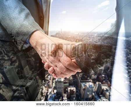 Business people shaking their hands. Double exposure effect