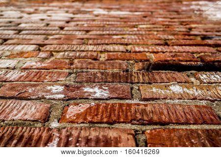 Brickwork. Grunge brick wall. Rough brick wall. Grunge brick background. Wet brick wall. Brick wall