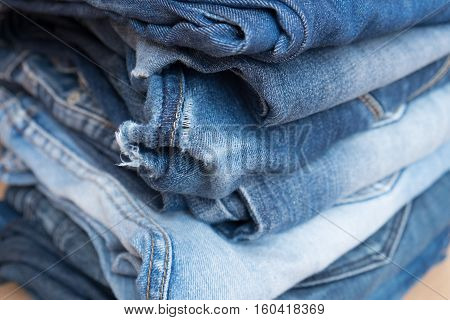 Pile Of Blue Jeans Trousers In A Shop