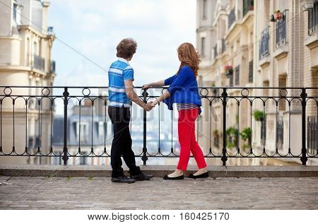 Couple Of Young Tourists On Montmartre Enjoying The View From The Observation Point