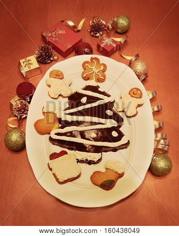 Homemade christmas cake in shape of christmas tree and cookies. Vintage style