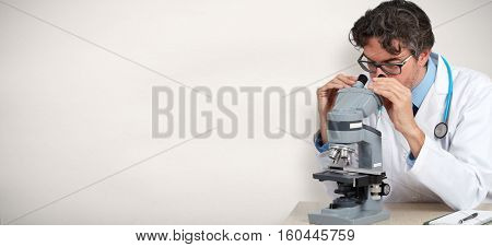 Doctor scientist with microscope.