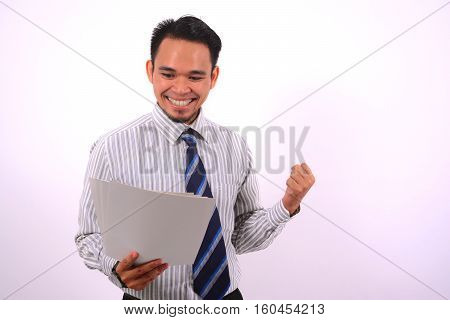 succesful asian bussinessman, very happy look at the white paper