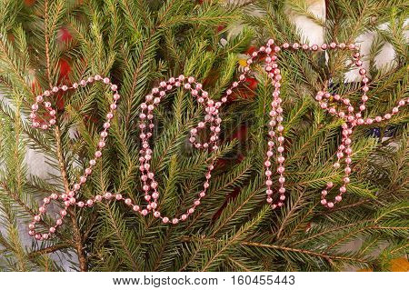 Christmas festive decoration of fir branches beads. Christmas and New Year's background.