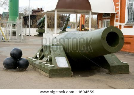 Old Artillery Piece With Shells