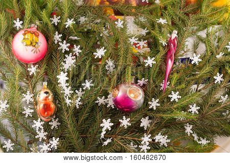 Christmas festive decoration of fir branches snowflakes Christmas tree decorations. Christmas and New Year's background.