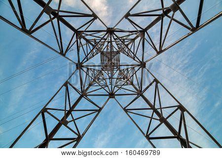 inside of electrical steel pylon on blue sky