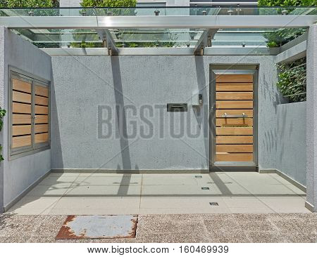 modern house grey wall entrance with wooden door