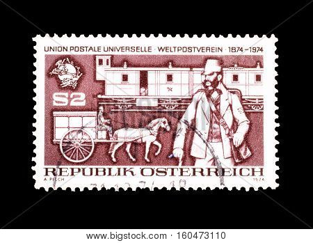 AUSTRIA - CIRCA 1974 : Cancelled stamp printed by Austria, that shows Postman.