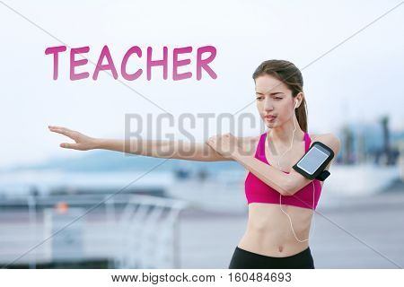 Young woman doing exercises on pier. Word TEACHER on background. Sport concept.
