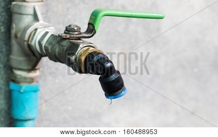 Wasting water - water drop from water tap