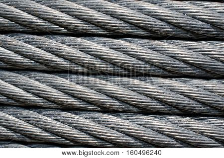 Strong sturdy heavy duty cable wire.  Industrial strength metal cable cord to be used for tie down or zip line.  Up close for background or backdrop.