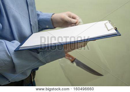 crime scene investigation. evidence. knife at the crime scene