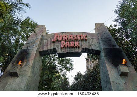 ORLANDO USA - NOVEMBER 1 2016: Entrance to Jurassic Park ride. Universal Studios Orlando is a theme park resort in Orlando Florida USA