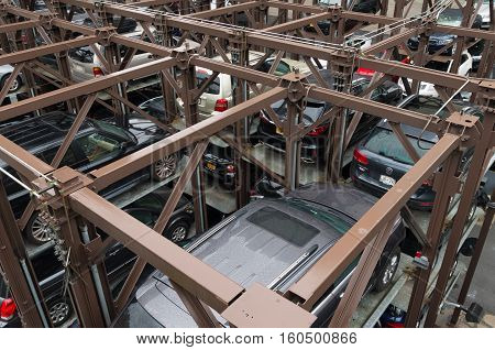 NEW YORK CITY - MAY 1 2016: Due to lack of space cars are parked on elevated parking places in Chelsea a neighbourhood in Manhattan