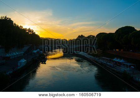Beautiful Vibrant sunset image of the Tiber River at sunset, Vatican City, Rome, Italy
