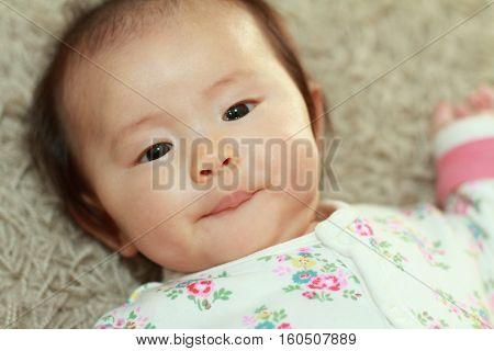 Smiling Japanese baby girl (0 year old)