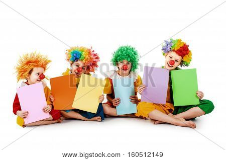 Funny clowns holding colorful sheets isolated on white
