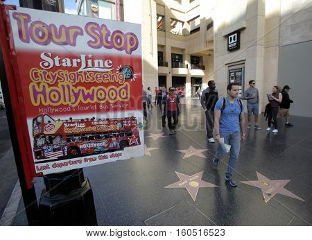 HOLLYWOOD, WEDNESDAY, NOVEMBER 16, 2016: Pedestrians on the Hollywood Walk of Fame, Hollywood Boulevard.