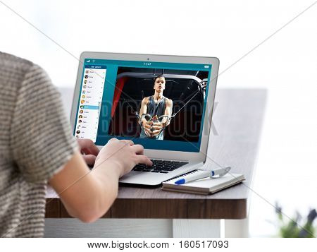 Woman watching sport training online on laptop. Fitness and sport blog.