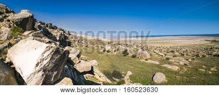 Panoramic view on Qobustan national park and caspian lake behind, Azerbaijan.