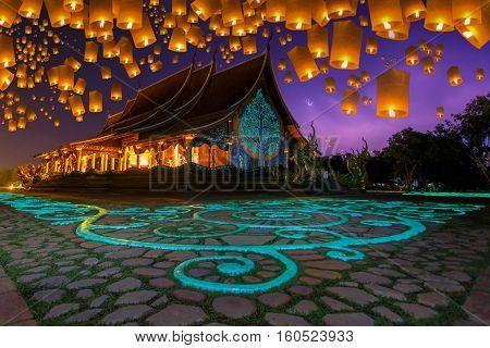 Floating lamp in yee peng festival at pagoda tree glow temple Wat Sirindhorn Wararam Sirindhorn District Ubon Ratchathani Thailand