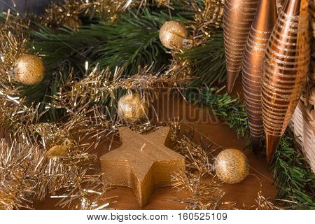 Christmas still life with brown and golden christmas toys