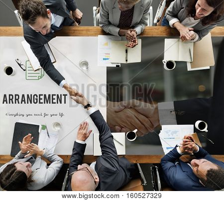 Arrangement word on business handshake background