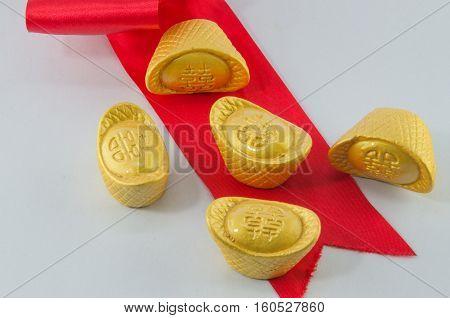 Gold ingot Red ribbon bow on white background.