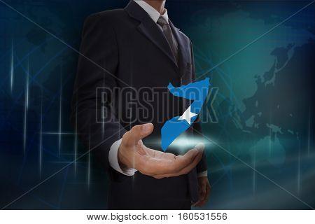 Businessman showing map of Somalia on globe background