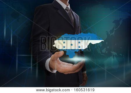 Businessman showing map of Honduras on globe background