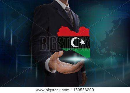 Businessman showing map of Libya on globe background