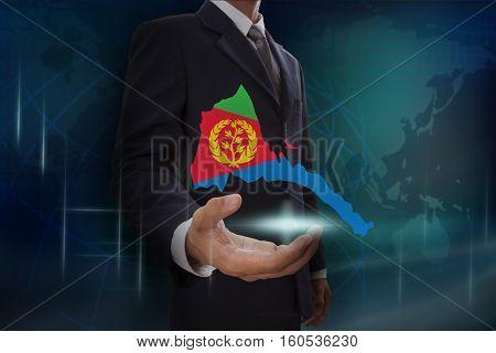 Businessman showing map of Eritrea on globe background