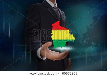 Businessman showing map of Bolivia on globe background