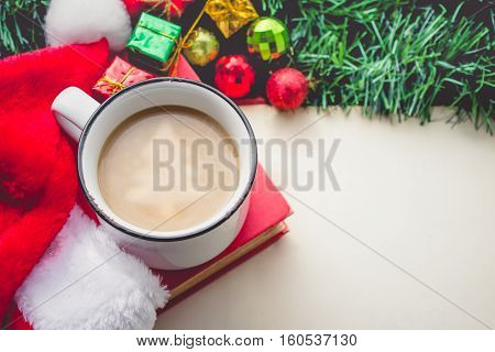 Christmas tree in Coffee Cup with Santa Hat and Decorations and Blank Space Vintage Tone
