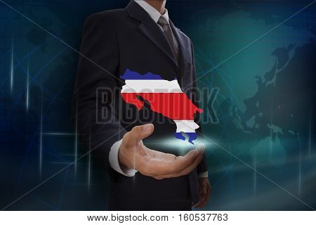 Businessman showing map of Costa Rica on globe background