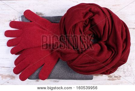 Womanly Woolen Clothes For Winter On Old Wooden Background