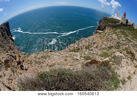Fisheye view of Saint Vincent Cape and lighthouse in Algarve Portugal