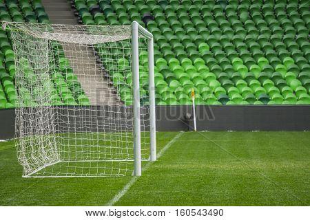 Football, soccer field. Soccer goal. Background of soccer football goal in stadium on match day.