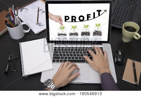 business hand typing on laptop keyboard with Profit homepage on the computer screen. benefit financial income growth concept.