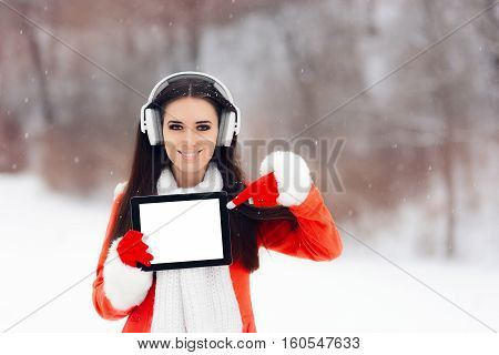 Smiling  Girl with Headphones Holding Tablet Pc