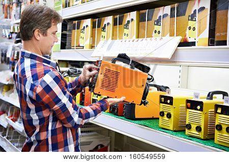 Man Chooses Welding Machine In Store