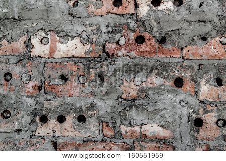 Brickwork. Grunge brick wall. Rough brick wall. Grunge brick background. Bricks covered with cement