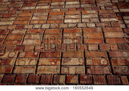 Brickwork. Grunge brick wall. Rough brick wall. Grunge brick background. Dark brick background