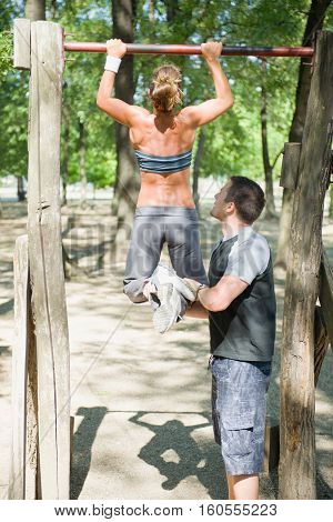 Pull Ups With Fitness Trainer