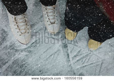 mother and child skating together in winter anture