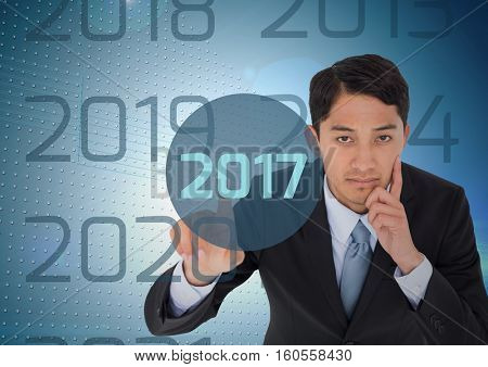 Portrait of thoughtful business man in digitally generated background touching 2017 new year